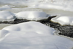 Snowy Mounds and Ice Surround Open <br /> Water on the River in Wintry Gilsum New Hampshire