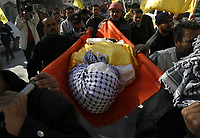 "Gaza.19.01.2008Palestinian carry the body  of Haniya Abd Al-Jawwad, front the damge, during her funeral procesision, in Gaza City, Saturday Jan. 19, 2008. Al-Jawwad was killed Friday when Israel bombed an empty Hamas-run government ministry in an intensifying campaign to halt rocket fire on Israeli border towns. Thirty-six Gazans have been killed in Israeli attacks since Tuesday, including at least 10 civilians.""photo by Fady Adwan"