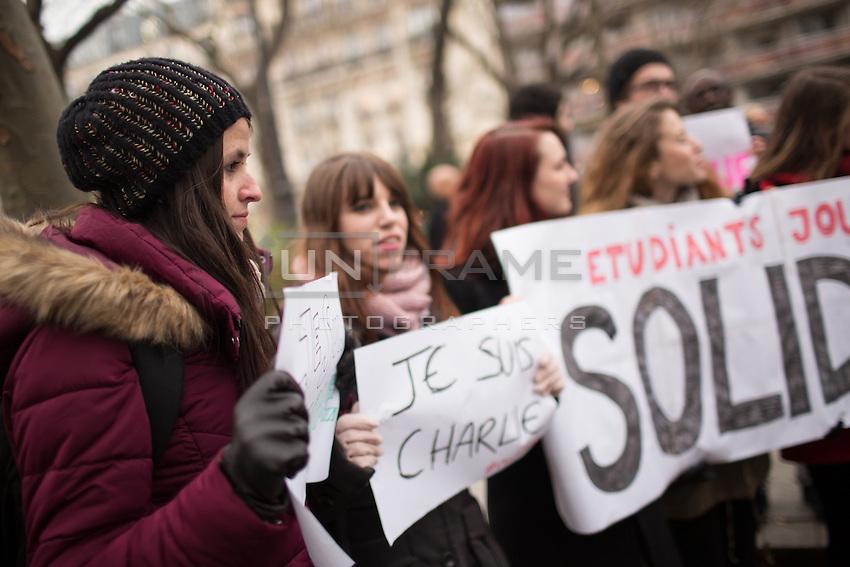 Demonstrators near the site of the massacre at Charlie Hebdo in Paris where masked gunmen killed 12 people. Paris, France, (Jan. 7, 2015).