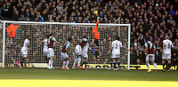 Pictured: Swansea goalkeeper Gerhard Tremmel (in orange) punches the ball away from a West Ham cross. 01 February 2014<br /> Re: Barclay's Premier League, West Ham United v Swansea City FC at Boleyn Ground, London.