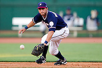 Anthony Seratelli (2) of the Northwest Arkansas Naturals attempts to make a play on a ball during a game against the San Antonio Missions at Arvest Ballpark on June 30, 2011 in Springdale, Arkansas. (David Welker / Four Seam Images)