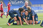 Lizzie Arnot of Manchester United Women scores the goal for Man Utd...cele underneath team mates