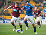 St Johnstone v Hearts....24.03.12   SPL.Fran Sandaza holds off Darren Barr.Picture by Graeme Hart..Copyright Perthshire Picture Agency.Tel: 01738 623350  Mobile: 07990 594431