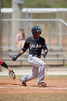 Miami Marlins Samuel Castro (10) follows through on a swing during a minor league Spring Training game against the New York Mets on March 26, 2017 at the Roger Dean Stadium Complex in Jupiter, Florida.  (Mike Janes/Four Seam Images)