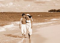 Couple walking on tropical beach.
