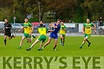 Darragh  Ballymac  claims the loose ball ahead of Sean O'Keeffe Gneeveguilla during their Junior Championship quarter final in Castleisland on Saturday
