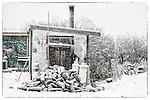 Shack in Woodyard in snowstorm