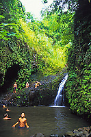 EDITORIAL ONLY. Hikers splash in a mountain pool at the end of Maunawili Falls trail.  Near Kailua, Windward Oahu