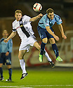 Ayr Utd's Craig Malcolm and Forfar's Gavin Malin challenge for the ball.