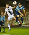 Ayr Utd's Craig Malcolm and Forfar's Gavin Malin challenge for the ball.