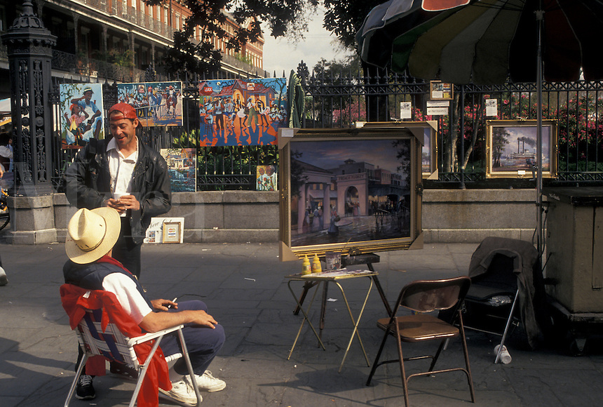 street artist, New Orleans, French Quarter, Louisiana, LA, Street artist display paintings on the sidewalk in the French Quarter of New Orleans.