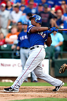 "Texas Rangers third baseman Adrian Beltre #29 follows through on a first inning home run during the MLB exhibition baseball game against the ""AAA"" Round Rock Express on April 2, 2012 at the Dell Diamond in Round Rock, Texas. The Rangers out-slugged the Express 10-8. (Andrew Woolley / Four Seam Images)."