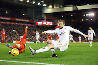 Gylfi Sigurdsson slips as he attempts to cross the ball during the Barclays Premier League Match between Liverpool and Swansea City played at Anfield, Liverpool on 29th November 2015