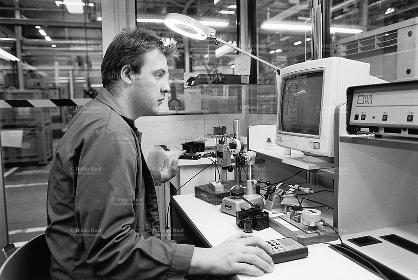 """France. Saône-et-Loire department. Chalon-sur-Saône. Kodak factory. Camera recycling. The """"ready to take pictures"""" camera is a small camera commonly described as disposable but in fact assembled for customers to return it after use. After being dismantled, verified and meticulously cleaned, some pieces are reused, other recycled (86%). The plastics parts are torn, melted, recasted and then reassembled. A worker measures and controls on the computer accuracy's level of the plastic parts.  Eastman Kodak Company. Chalon-sur-Saône is located in the south of the Burgundy region. © 1996 Didier Ruef ."""