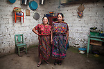 For GLOBAL FUND FOR WOMEN<br /> <br /> Gloria and her mother Juanita at their home. Gloria Marina Icu Puluc from Asociación Civil de Comadronas Tradicionales de Chimaltenango (ACOTCHI) in San Juan Comalapa, Guatemala on August 20, 2015. Photo credit: Bénédicte Desrus