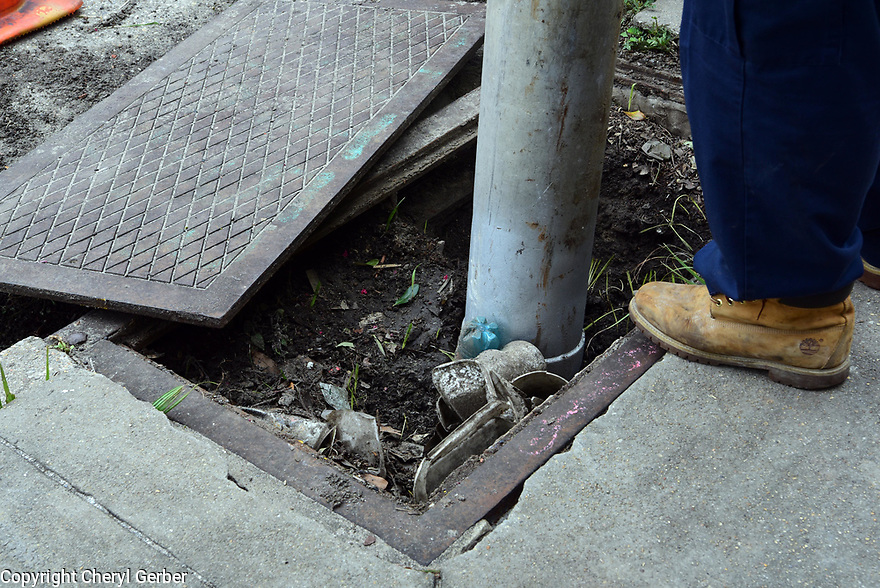 City sub-contractors help cleaning out clogged catch basins ahead of Tropical Storm Barry, which is expected to make landfall as a Category 1 hurricane on Sat., in New Orleans, Fri., July, 12, 2019.