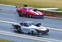 Apr. 29, 2011; Baytown, TX, USA: NHRA pro mod driver Melanie Troxel (near) races Jay Payne during qualifying for the Spring Nationals at Royal Purple Raceway. Mandatory Credit: Mark J. Rebilas-