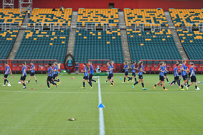 Members of Netherlands perform drills before team practice on the eve of inaugural Women's World Cup Soccer match, Friday June 05, 2015 in Edmonton, Alberta. (Mo Khursheed/TFV Media via AP Images)