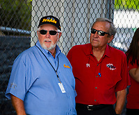 May 4, 2018; Commerce, GA, USA; NHRA sponsor Ron Thames (left) with team owner Don Schumacher during qualifying for the Southern Nationals at Atlanta Dragway. Mandatory Credit: Mark J. Rebilas-USA TODAY Sports
