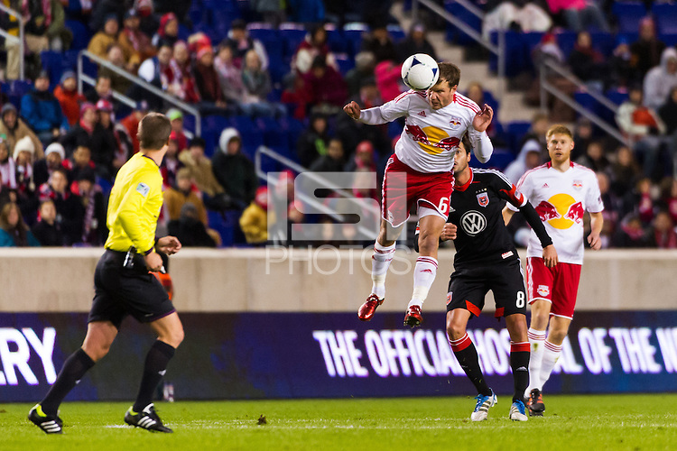 Teemu Tainio (6) of the New York Red Bulls heads the ball. D. C. United defeated the New York Red Bulls 1-0 (2-1 in aggregate) during the second leg of the MLS Eastern Conference Semifinals at Red Bull Arena in Harrison, NJ, on November 8, 2012.