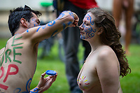 People prepare for the Cardiff World Naked Bike Ride on the front lawn of Cardiff University on 25 July 2021. The bike ride aims to highlight the vulnerability of cyclists against traffic in cities, with the human body presented as a contrast to high powered vehicles. Photo by Mark Hawkins.