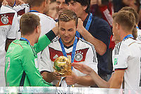 Mario Gotze of Germany looks at the trophy after winning the FIFA World Cup