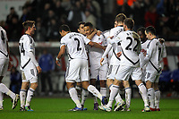 Pictured: Scott Sinclair of Swansea (C) mobbed by team mates celebrating after scoring his opening goal. Tuesday, 31 January 2012<br /> Re: Premier League football Swansea City FC v Chelsea FCl at the Liberty Stadium, south Wales.