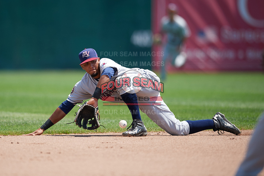 Mahoning Valley Scrappers shortstop Elvis Perez (6) makes a diving stop during the first game of a doubleheader against the Auburn Doubledays on July 2, 2017 at Falcon Park in Auburn, New York.  Mahoning Valley defeated Auburn 3-0.  (Mike Janes/Four Seam Images)