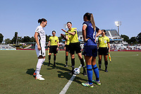 CARY, NC - SEPTEMBER 12: Captains Christine Sinclair #12 of the Portland Thorns FC and Abby Erceg #6 of the North Carolina Courage watch as Referee Matt Franz performs the ceremonial coin toss before a game between Portland Thorns FC and North Carolina Courage at Sahlen's Stadium at WakeMed Soccer Park on September 12, 2021 in Cary, North Carolina.