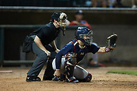 Mississippi Braves catcher Shea Langeliers (4) sets a target as home plate umpire Austin Jones looks on during the game against the Birmingham Barons at Regions Field on August 3, 2021, in Birmingham, Alabama. (Brian Westerholt/Four Seam Images)