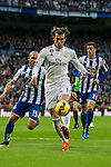 Real Madrid´s Gareth Bale and Deportivo de la Coruna's Laureano Sanabria Ruiz during 2014-15 La Liga match between Real Madrid and Deportivo de la Coruna at Santiago Bernabeu stadium in Madrid, Spain. February 14, 2015. (ALTERPHOTOS/Luis Fernandez)