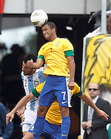 Brazil substitute midfielder Lucas (7) heads the ball. In an international friendly (Clash of Titans), Argentina defeated Brazil, 4-3, at MetLife Stadium on June 9, 2012.