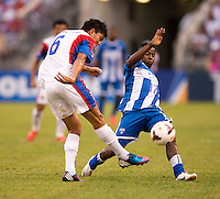 Marvin Chavez (17) of Honduras blocks the pass of Juan Diego Madrigal (6) of Costa Rica during the quarterfinals of the CONCACAF Gold Cup at M&T Bank Stadium in Baltimore, MD.  Honduras defeated Costa Rica, 1-0.
