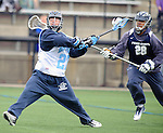 Baltimore- February 4: Rob Guida of Hopkins fires at the goal during the exhibition between Johns Hopkins and Penn State at Homewood Field on February 04, 2012 in Baltimore, MD.