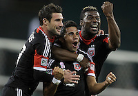 WASHINGTON, DC - OCTOBER 20, 2012:  Chris Pontius (13), Marcelo Saragosa (11), and Brandon McDonald (4) of D.C United after Marcelo Saragosa (11) had scored the second goal against the Columbus Crew during an MLS match at RFK Stadium in Washington D.C. on October 20. D.C United won 3-2.