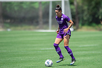 SANFORD, FL - APRIL 3: Ali Krieger of the Orlando Pride dribbles the ball during a game between Florida State Seminoles and Orlando Pride at Sylvan Park Training Center on April 3, 2021 in Sanford, Florida.