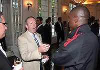 Kevin Payne of DC United makes a point to Clarence Seedorf of AC Milan at a reception for AC Milan at DAR Constitution Hall in Washington DC on May 24 2010.