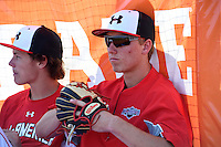 Kody Clemens (2) of Memorial High School in Houston, Texas sits with Ryan Mountcastle (5) of Paul J. Hagerty High School in Winter Springs, Florida (left) during the Under Armour All-American Game practice on August 15, 2014 at Les Miller Field in Chicago, Illinois.  (Mike Janes/Four Seam Images)