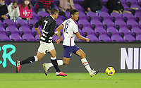 ORLANDO CITY, FL - JANUARY 31: Mile Robinson #12 of the United States passes off the ball during a game between Trinidad and Tobago and USMNT at Exploria stadium on January 31, 2021 in Orlando City, Florida.