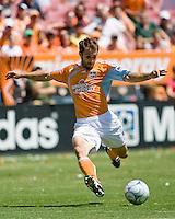 Houston Dynamo midfielder Brian Mullan (9) strikes the ball.  Houston Dynamo defeated Colorado Rapids 1-0 at Robertson Stadium in Houston, TX on April 19, 2009.