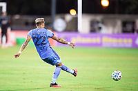 LAKE BUENA VISTA, FL - JULY 14: Ronald Matarrita #22 of NYCFC kicks the ball during a game between Orlando City SC and New York City FC at Wide World of Sports on July 14, 2020 in Lake Buena Vista, Florida.