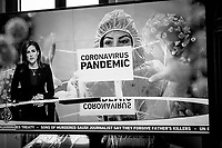 """Switzerland. Canton Ticino. Lugano. Al Jazeera television.  An anchorwoman presents the news about  the global Coronavirus Pandemic. A smiling nurse is dressed in hazmat suit and gloves. The molecular biology  of the coronavirus ( also called Covid-19). Breaking news scroll as text: """"the sons of the Martyr Jamal Khashoggi pardon those who killed their father"""". Al Jazeera is a Qatari state-funded broadcaster in Doha, Qatar, owned by the Al Jazeera Media Network. Initially launched as an Arabic news and current affairs satellite TV channel, 22.05.2020 © 2020 Didier Ruef"""