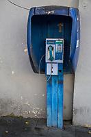 Yogyakarta, Java, Indonesia.  Coin-operated Public Telephone in use in 2014.