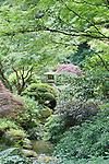 Lantern in Garden.  Portland, Oregon, Japanese GardenThe Japanese Garden in Portland is a 5.5 acre respit.  Said to be one of the most authentic Japanese Garden's outside of Japan, the rolling terrain and water features symbolize both peace and strength.