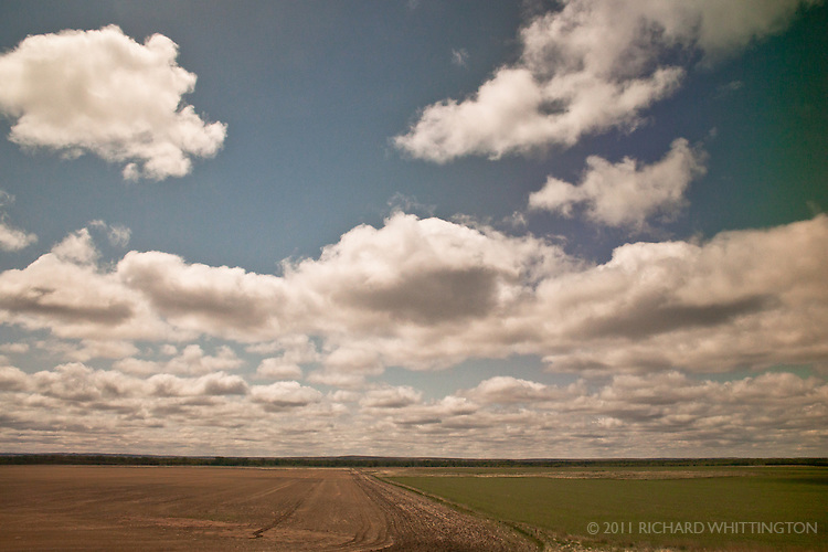 Amtrak's Empire Builder train route runs 2,206 miles from Chicago to Seattle through Illinois, Wisconsin, Minnesota, North Dakota, Montana, Idaho, and Washington. The vast expanse of wide open space with ever-changing dramatic cloudscapes was special.