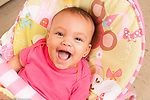 5 month old baby girl in infant seat portrait closeup