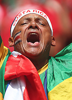 A Costa Rica supporter cheers his team on