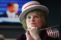 Julie Rutz of West Des Moines listens as President Barack Obama delivers his inaugural address during an inauguration watch party on January 20, 2009 in West Des Moines, Iowa.