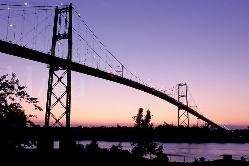 bridge, International Bridge, Thousand Islands, Alexandria Bay, New York, St. Lawrence River, NY, International Bridge at sunset crosses the St. Lawrence River into Ontario, Canada.