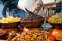 Locally-produced olives for sale at the stall 'Chez Titou' at Le Marché Provencal [The Provencal Market], Antibes, France, 16 October 2013